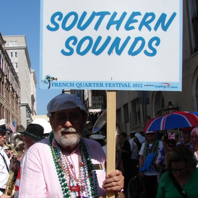 Southern Sounds sign for the French Quarter Festival Parade